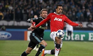 Nani runs past Gabriel Heinze during Manchester United's draw with Marseille in the Champions League