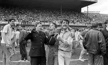 An injured fan receives attention during the Hillsborough disaster of 1989