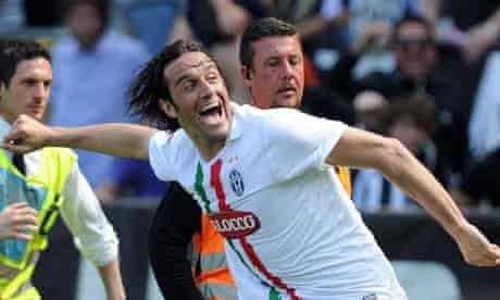 Luca Toni celebrates his winner against Genoa