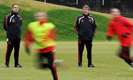 Steve Clarke, left, and Kenny Dalglish oversee training at Liverpool's Melwood base