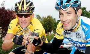 Lance Armstrong and team-mate George Hincapie toast the Texan's 2005 Tour de France win