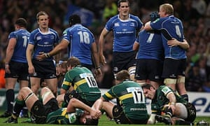 Leinster players celebrate victory in the Heineken Cup final while Northampton players look dejected