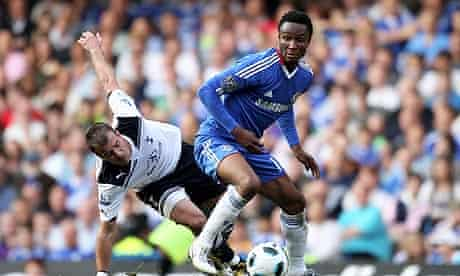 Mikel John Obi holds off Rafael van der Vaart during Chelsea's win against Tottenham