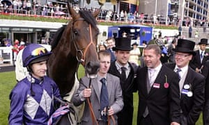Owner Michael Owen, centre, with jockey Richard Kingscote, left, after Brown Panther's win