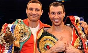 Wladimir Klitschko, right, celebrates with brother Vitali