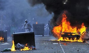 A car burns in Hackney during the rioting which engulfed London last week