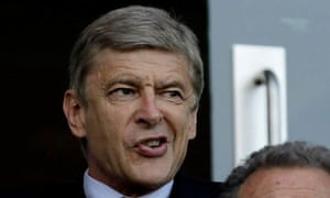 Arsene Wenger watches Arsenal's Champiions LEague qualifying match against Udinese from tehr stands