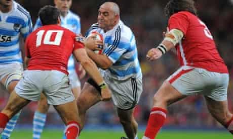 Argentina's Mario Ledsma runs at James Hook, the Wales fly-half, in Cardiff.