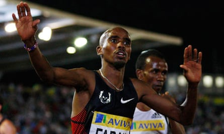 Mo Farah celebrates after his 3,000m victory