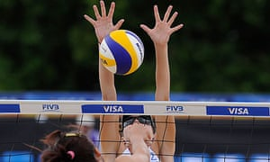 Elizabeth Maloney of Canada makes a block in her match with partner Heather Barnsley