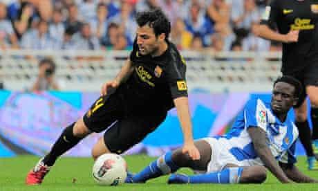 Cesc Fabregas is tackled by Macdonald Mariga