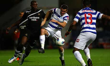 Joey Barton of QPR battles with Newcastle's Shola Ameobi
