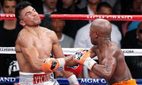 Victor Ortiz is floored by Floyd Mayweather