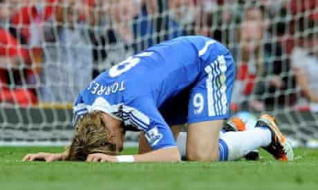 Fernando Torres waits for the ground to swallow him up after that miss for Chelsea