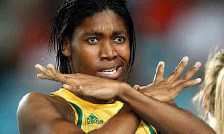 Caster Semenya gestures after winning her women's 800 metres semi-final