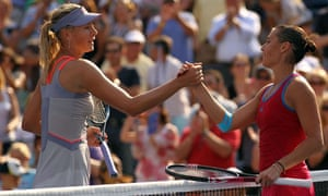 Flavia Pennetta shaking hands with Maria Sharapova