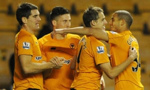 David Edwards celebrates with team-mates after scoring Wolves' first goal against Millwall
