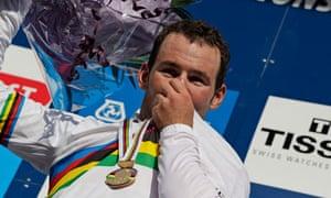 New world champion Mark Cavendish of Britain kisses his rainbow jersey