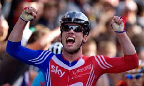 Mark Cavendish celebrates as he crosses the finish line
