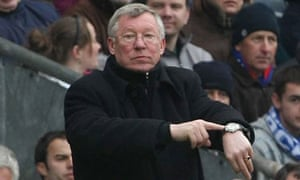 Sir Alex Ferguson points to his watch