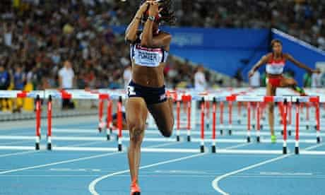 Britain's Tiffany Porter reacts after finishing fourth in the women's 100m hurdles fina