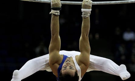 Daniel Keatings of Great Britain in action on the parallel bars.