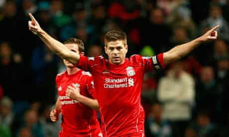 Steven Gerrard celebrates scoring his penalty