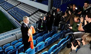 Mark Hughes poses for photos shortly after being introduced as the new Queens Park Rangers manager