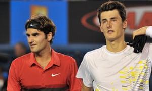 Roger Federer walks off with Bernard Tomic
