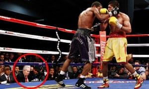 Amir Khan has questioned the presence of a mystery man in a hat at his defeat to Lamont Peterson