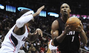 25a678a06be Miami Heat s Chris Bosh and Atlanta Hawks  ...