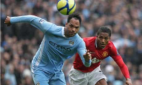 Joleon Lescott in action against Manchester United