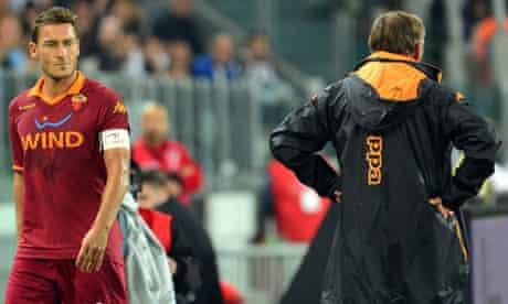 Francesco Totti looks at Zdenek Zeman