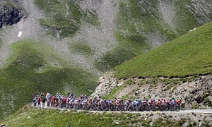 The pack of riders cycles during the 17th stage of the Tour de France