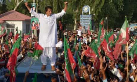 Pakistani politician Imran Khan stands on a vehicle in Mianwali, northern Pakistan