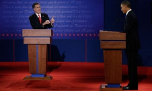 Republican presidential nominee Mitt Romney points to President Barack Obama during the first debate