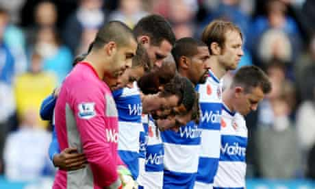 The Reading players observe a minute silence