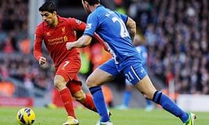 Luis Suárez of Liverpool and Ivan Ramis of Wigan Athletic