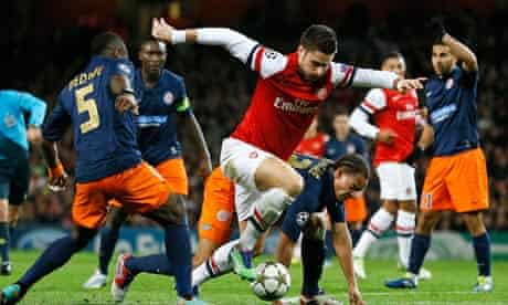 Arsenal's Olivier Giroud takes on the Montpellier defence