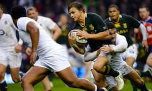 South Africa's Pat Lambie is tackled by Brad Barritt during the autumn international at Twickenham
