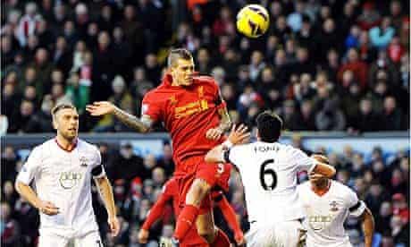 Daniel Agger of Liverpool scores