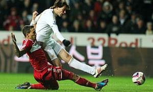 Middlesbrough's Seb Hines tackles Swansea's Michu