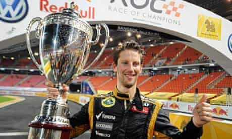 Romain Grosjean celebrates with the Race of Champions trophy