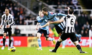 Newcastle United's Mike Williamson, right, challenges Queens Park Rangers's Adel Taarabt
