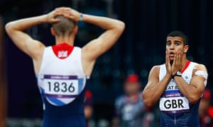 Adam Gemili, right, and Daniel Talbot react after being disqualified at London 2012