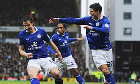 Leicester City's Sean St Ledger, left, celebrates scoring the opening goal against Norwich City