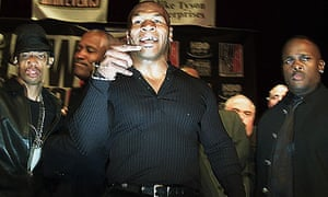 Mike Tyson shouts at reporters after a brawl broke out with Lennox Lewis in New York in 2002