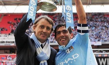 Roberto Mancini and Carlos Tevez