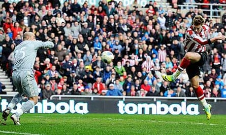 Sunderland's Nicklas Bendtner scores the opening goal against Liverpool