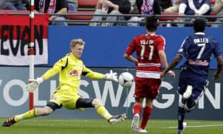 New York Red Bulls goalkeeper Ryan Meara saves from FC Dallas' Ricardo Villar. MLS